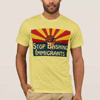 Pare el golpear de la camiseta de los inmigrantes
