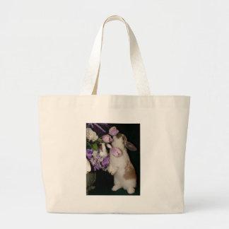 Pare y huela el bolso de las flores bolsa