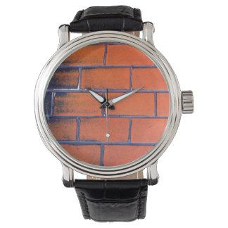 pared de ladrillo 2 relojes de mano