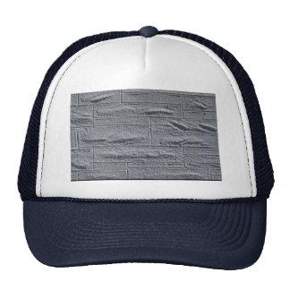 Pared de ladrillo blanca texturizada ilustrativa gorras