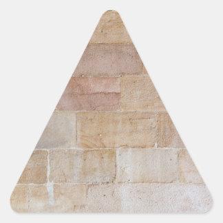 Pared de ladrillo color nata vieja pegatina triangular