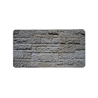 Pared de ladrillo de piedra inconsútil etiqueta de dirección