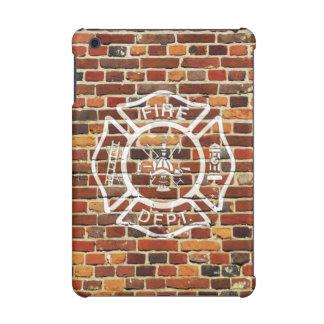 Pared de ladrillo del logotipo del bombero