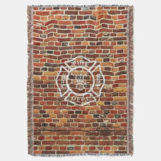 Pared de ladrillo del logotipo del bombero manta