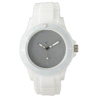pared de ladrillo gris relojes de mano