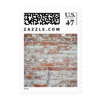 Pared de ladrillo resistida timbre postal