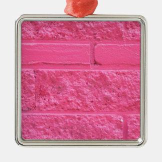 Pared de ladrillo rosada adorno cuadrado plateado