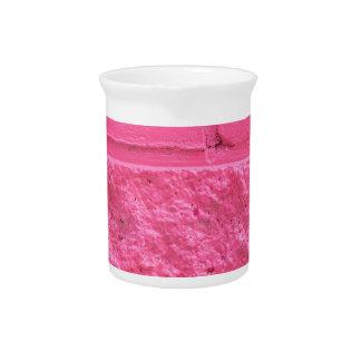 Pared de ladrillo rosada jarron
