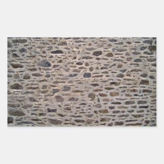 Pared de piedra con el modelo irregular rectangular altavoces