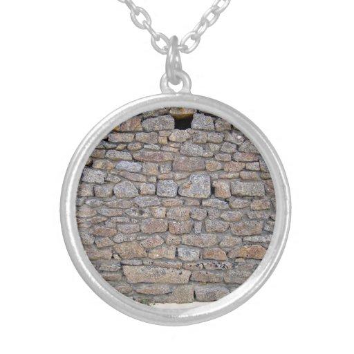 Pared de piedra con el solo agujero y las pequeñas colgantes personalizados