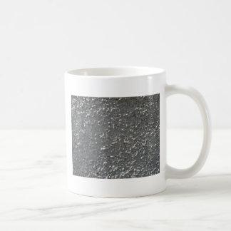 Pared del cemento gris con una superficie áspera taza clásica