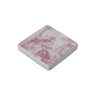 Pared sucia, rosada imán de piedra