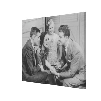 Parents and daughter (6-7) talking with male canvas print