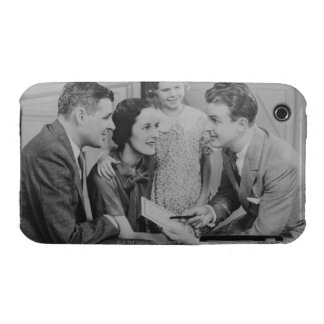 Parents and daughter (6-7) talking with male Case-Mate iPhone 3 case