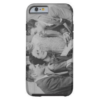 Parents and daughter (6-7) talking with male tough iPhone 6 case