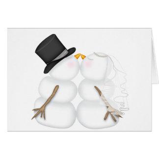 Pares adorables del muñeco de nieve que se besan tarjeta de felicitación