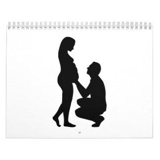 Pares de la mujer embarazada calendarios de pared