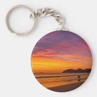 Pares de Rican de la costa en la puesta del sol Llavero