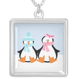Pares del pingüino collar plateado