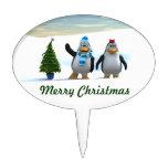Pares del pingüino con el árbol figura de tarta