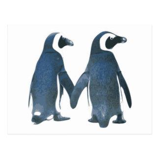 Pares del pingüino que llevan a cabo las manos postales