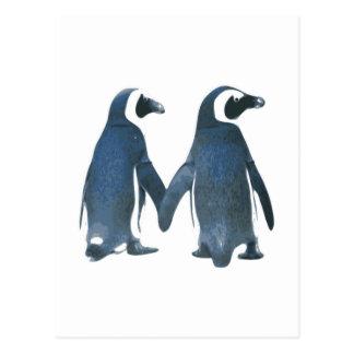 Pares del pingüino que llevan a cabo las manos postal