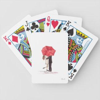 Pares en amor debajo del paraguas rojo cartas de juego