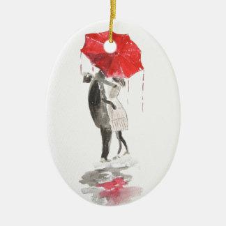 Pares en besarse del amor adorno navideño ovalado de cerámica