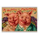 ¡Pares impares del cerdo de la tarjeta de Navidad