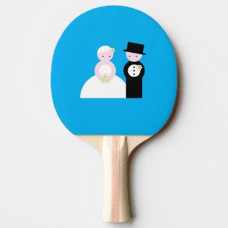 Pares lindos del boda pala de tenis de mesa