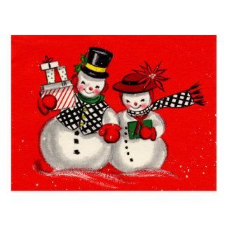 Pares lindos del muñeco de nieve postal