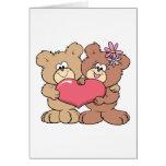 pares lindos del oso de peluche del corazón de la  tarjeta