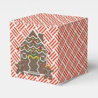 Pares lindos del pan de jengibre de la casa de pan caja para regalos de fiestas