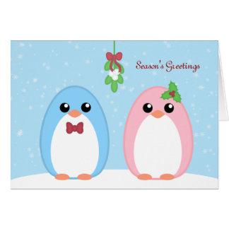 Pares lindos del pingüino del día de fiesta tarjeta de felicitación