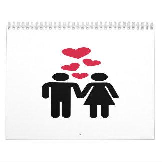 Pares rojos del amor de los corazones calendarios