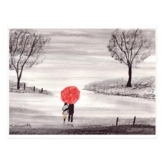 Pares rojos del amor del paraguas tarjeta postal