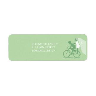 Pares verdes de la bicicleta que casan la etiqueta etiquetas de remite