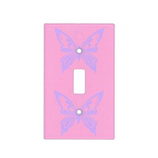 Pares violetas de la mariposa cubierta para interruptor