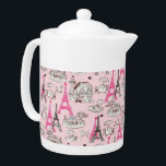 """Paris Promenade Teapot<br><div class=""""desc"""">Medium white Porcelain teapot with an image of pink and brown Eiffel Towers and Paris caf&#233; scenes on light pink. See matching candy jar, espresso cup, flask, pitcher, Melamine plate, paper plate and coasters. See the entire Cancan Teapot collection in the FOOD/BEV 