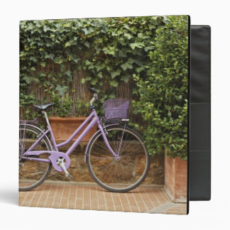 Parked bicycle, Pienza, Italy, Tuscany Binder