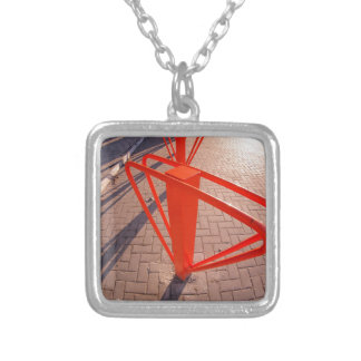 Parking for bicycles in the street closeup square pendant necklace