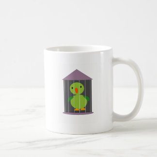 parrot in cage coffee mug