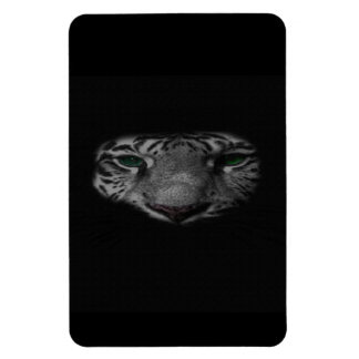Part of a black and white tiger's face on a magnet