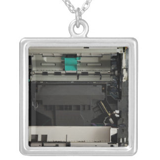 Part of the electronic interior of a laser printer silver plated necklace