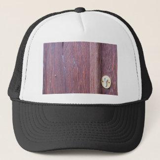 Part of the wooden door brown close-up with brass trucker hat