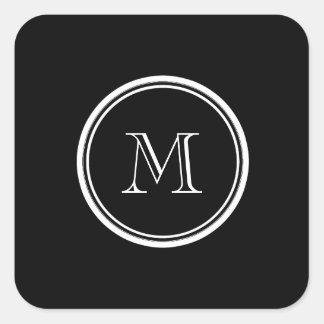 Parte alta negra inicial del monograma coloreada colcomanias cuadradass