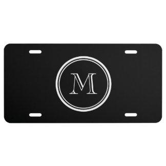 Parte alta negra inicial del monograma coloreada placa de matrícula