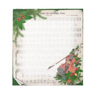 Partitura del navidad del vintage con el violín bloc de notas
