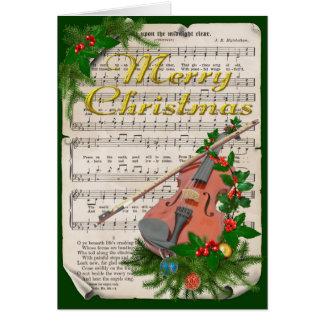 Partitura del navidad del vintage con el violín tarjeta de felicitación