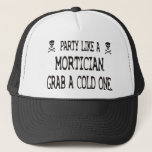 "Party Like A Mortician, Grab A Cold One Trucker Hat<br><div class=""desc"">Darker humor for the rockstar in you.</div>"